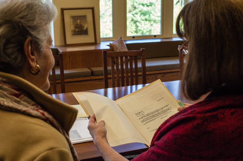 Clare Clark, Carnegie Library archivist, shows Mrs. Natalie Meyer the letter from Dr. Milislav Demerec comfirming her employment in his lab.