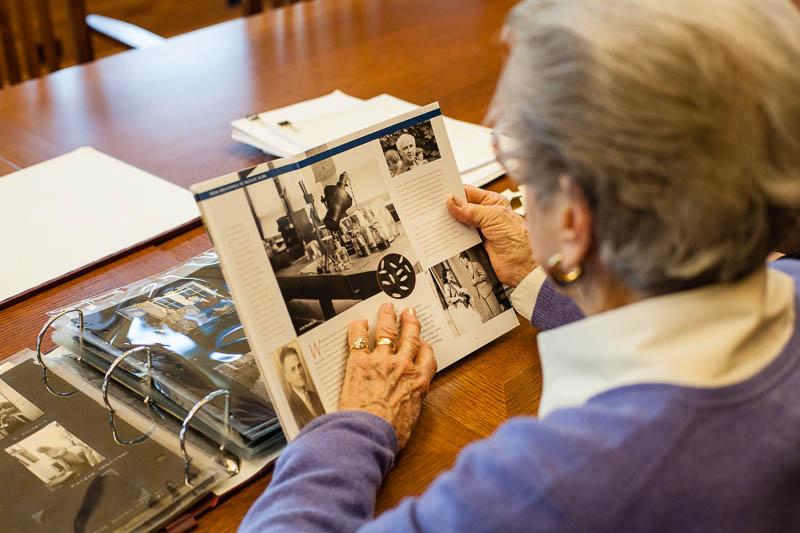 Mrs. Natalie Meyer, former employee of the lab from 1949-50, looks through the CSHL history about her former employers lab, Dr. Milislav Demerec