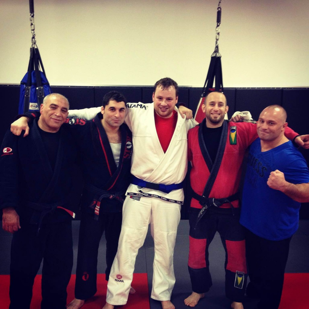 Photo: Nowak at his promotion to blue belt in 2013. From left to right, Nick Safar, Nick Serra, David Nowak, Mike Piccolomini, Matt Serra.